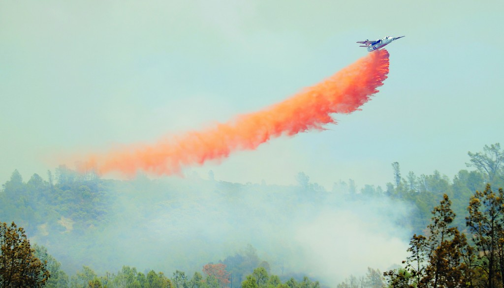 """A Cal Fire air tanker drops retardant on a spot fire off the main Butts Fire in Napa County, Calif. A wildfire near Northern California's Napa Valley wine country grew overnight on Thursday, devouring 4,300 acres and two houses, and prompting more evacuations, officials said. About 500 people have been evacuated from their homes as unpredictable winds continue to push the flames through rolling hills of dry brush and oak trees.""""Every effort is being made to render the evacuated community safe for repopulation,"""" said officials from the California Department of Forestry and Fire Protection, or CalFire. (Reuters)  (AP Photo/The Press Democrat, Kent Porter)"""