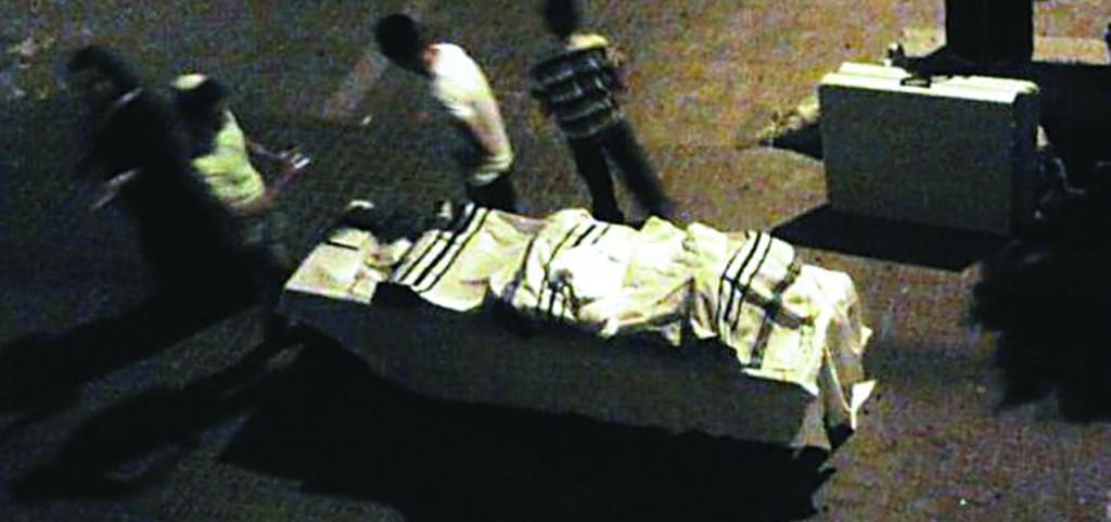 Burnt Sifrei Torah being prepared for burial. (Hatzalah)
