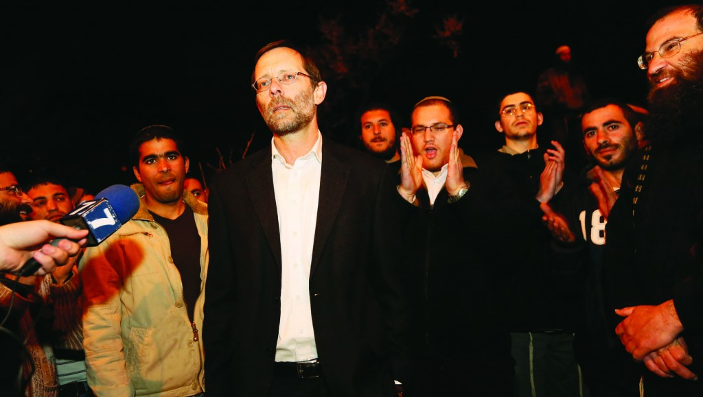 Likud MK Moshe Feiglin demonstrating his support for the Maalei Rechavam outpost on Wednesday night. (FLASH90)