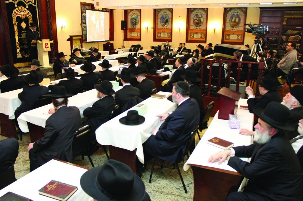 "On Thursday night, a kinus hesped v'zikaron was held l'iluy nishmas Rabbi Yosef Friedenson, z""l, editor of Dos Yiddishe Vort, who was niftar on Shabbos Parashas Zachor. The kinus took place in Boro Park at Agudath Israel Zichron Moshe. The Novominsker Rebbe, shlita (inset), Rosh Agudas Yisroel, addressed the gathering. The program also included Harav Dovid Olewski, Rosh Mesivta, Beis Yisroel of Ger, Rabbi Chaim Dovid Zweibel, Executive Vice President and Reb Yechiel Benzion Fishoff, Chairman Emeritus, Board of Trustees, Agudath Israel of America. (Photos: Hillel Engel)"