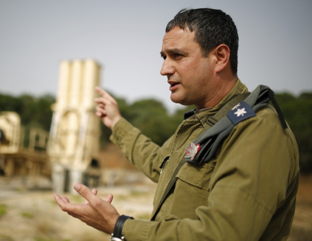 Colonel Tzvika Haimovich of the Israeli air defense corps points to an Arrow II battery, a U.S.-backed Israeli missile shield, during an interview with Reuters at his base in Palmachim, south of Tel Aviv, on Thursday. (REUTERS/Amir Cohen)