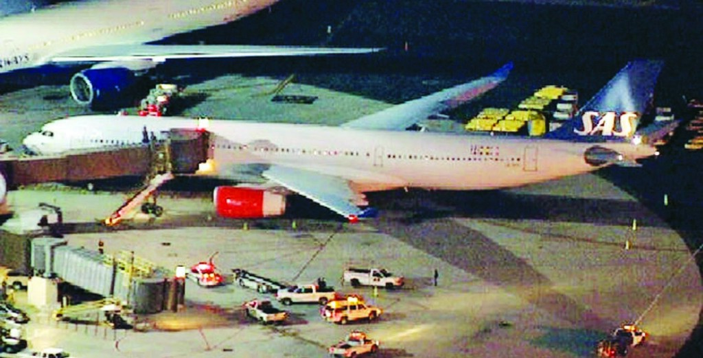 A damaged plane sits on the tarmac at Newark Liberty International Airport after clipping the wing of another aircraft on takeoff Wednesday evening. (AP Photo/WNBC)