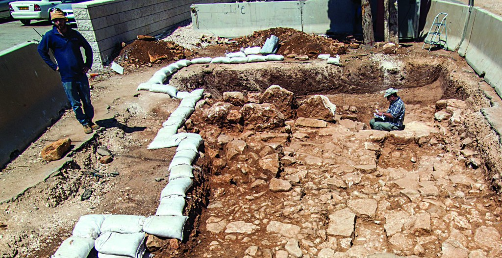 Assaf Peretz is seen at the site of an ancient, stone-paved, Roman road in Yerushalayim.(Photo: Courtesy of the Israel Antiquities Authority Archeological staff.)