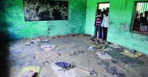 People look at a classroom where contaminated meals were served to children at a school at Chapra in the eastern Indian state of Bihar Wednesday. (REUTERS/Stringer)