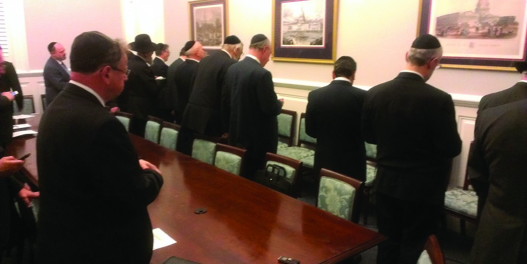 Agudath Israel's annual mission to Washington to lobby for Jewish concerns meets House Majority Leader Eric Cantor (R-Va.), and (R photo): Davening Minchah in House Speaker John Boehner's office.