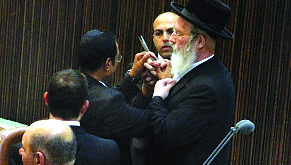 MK Yisrael Eicher (UTJ) tearing kriah in the Knesset.