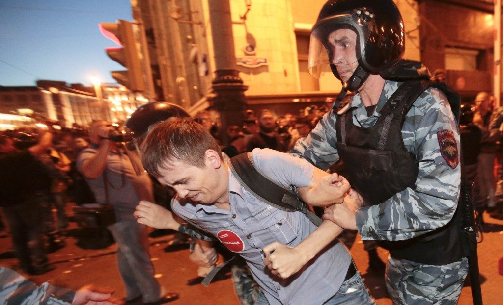 Riot police detain a man during a protest against the verdict of a court in Kirov, which sentenced Russian opposition leader Alexei Navalny to five years in jail, in central Moscow, Thursday. (REUTERS/Tatyana Makeyeva)