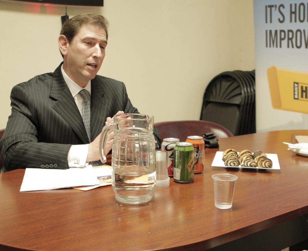 Chaim Deutch (L) being interviewed in Hamodia offices.
