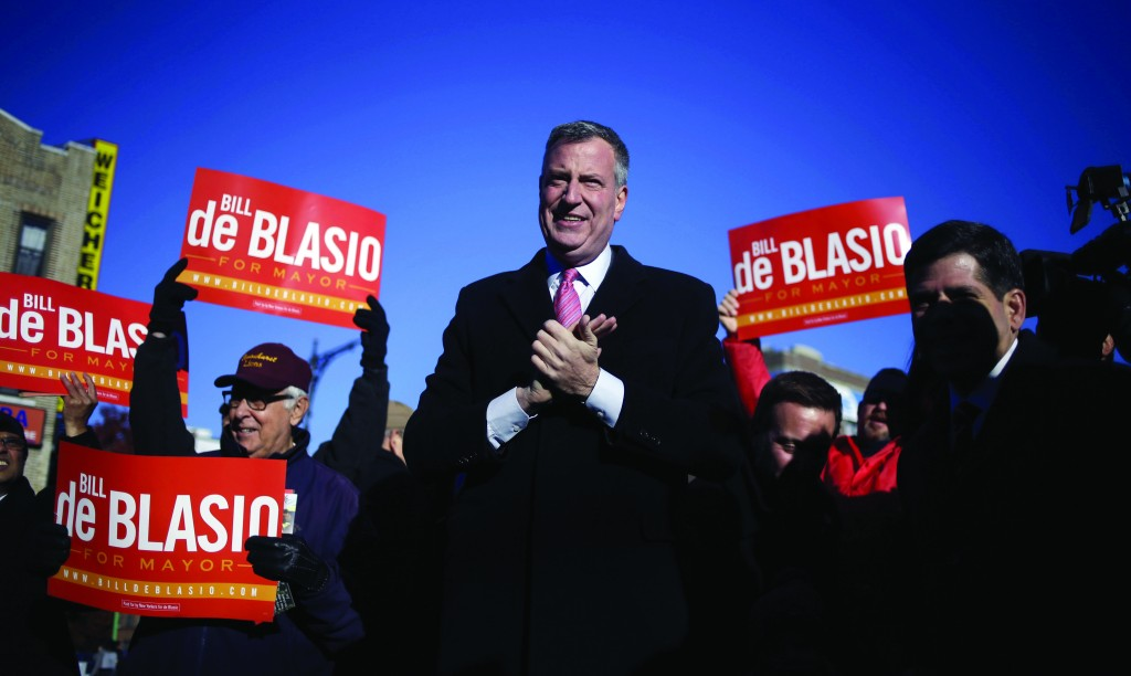Democratic New York City mayoral candidate Bill de Blasio campaigns at a subway stop in New York, Monday, Nov. 4, 2013. The mayoral election took place on Tuesday, Nov. 5, 2013. (AP Photo/Seth Wenig)
