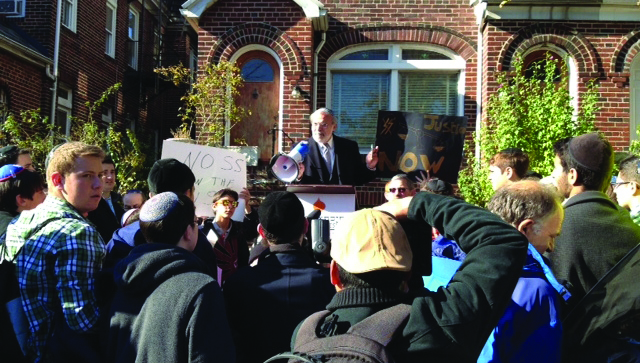 Assemblyman Dov Hikind at the rally in Queens Sunday in front of Nazi Jakiw Palij's home.