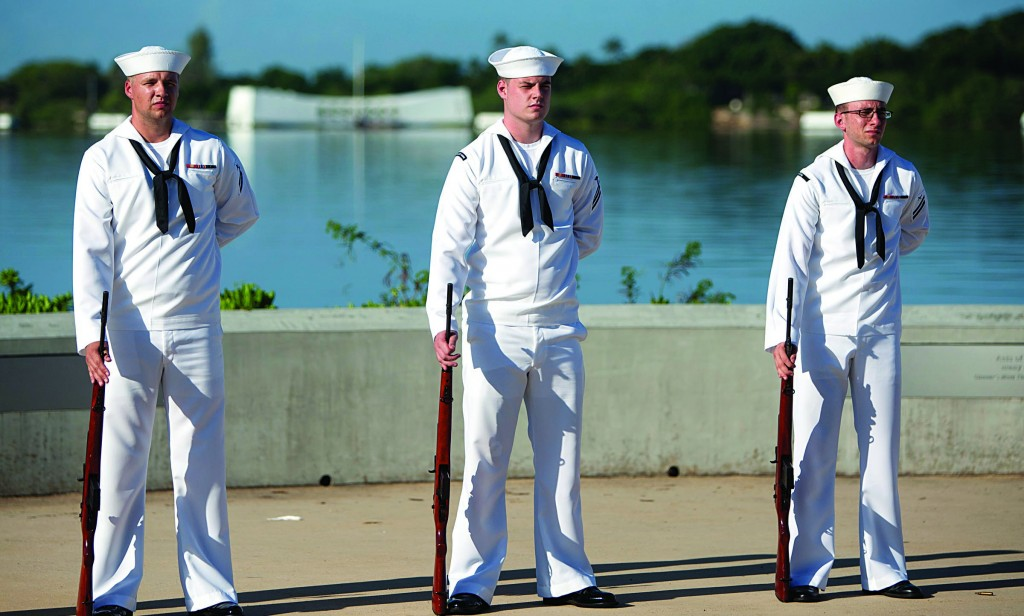 With the USS Arizona in the background, Navy rifleman stand during the ceremony commemorating the 72nd anniversary of the attack on Pearl Harbor, Saturday, in Honolulu. (AP Photo/Marco Garcia)
