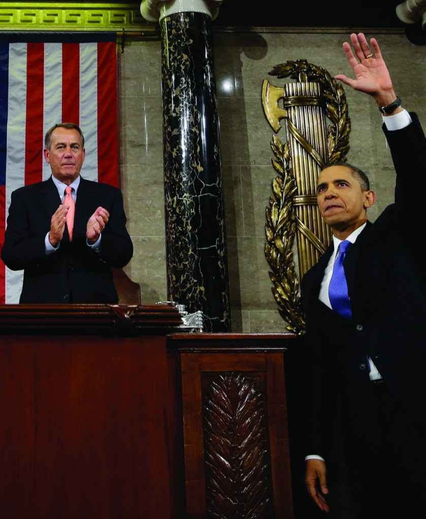 President Barack Obama waves and House Speaker John Boehner of Ohio applauds after the president gave his State of the Union address during a joint session of Congress on Capitol Hill in Washington last year. (AP Photo/Charles Dharapak, Pool)