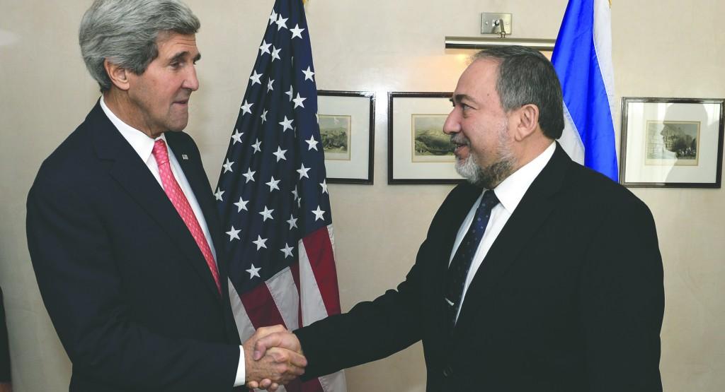 Israeli Foreign Minister Avigdor Lieberman (R) greets U.S. Secretary of State John Kerry (L) in Yerushalayim recently. (Matty Stern/US Embassy/Flash90)