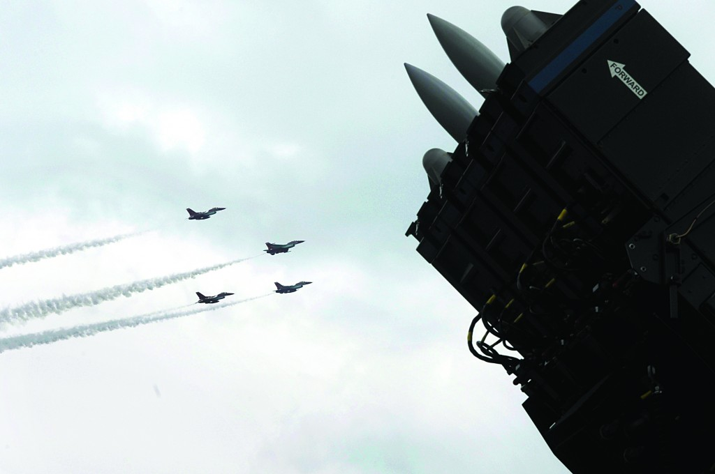 SPYDER, Rafael Advanced Defense Systems' surface-to-air missile system, was on display as F-16 fighter jets of the Singapore Air Force aerobatics team Black Knights performed on the fourth day of the Singapore Airshow in Singapore on Friday. (AP Photo/Joseph Nair)