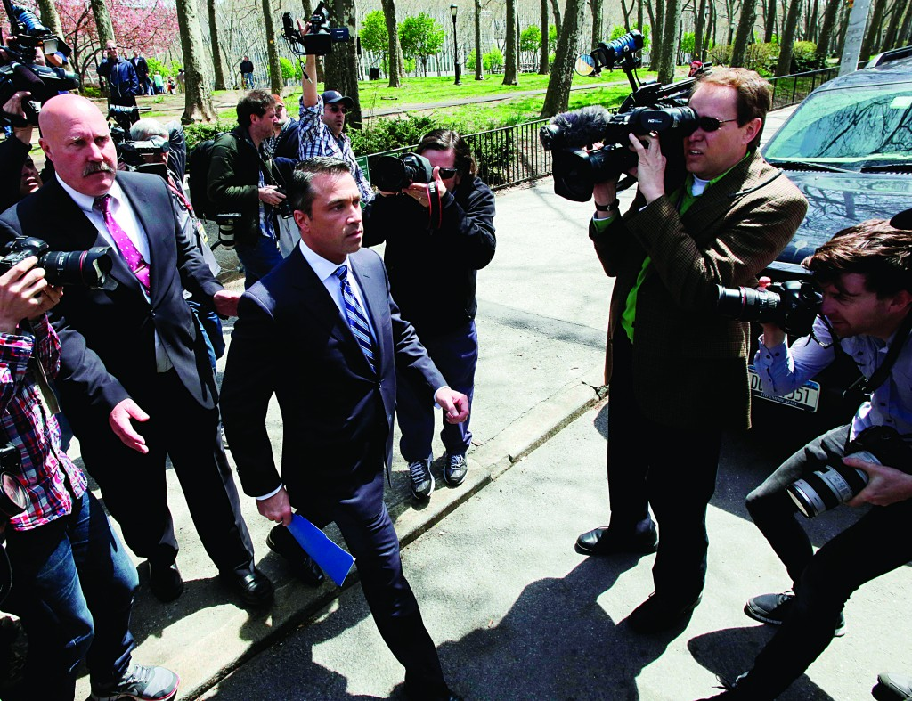 Rep. Michael Grimm on Monday leaves a news conference in a park near Brooklyn federal court. (AP Photo/Mark Lennihan)