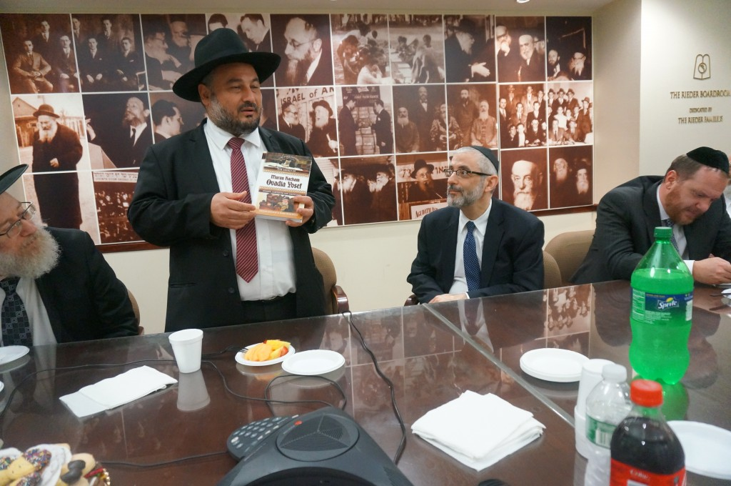 "Beit Shemesh Mayor Moshe Abutbul visited Agudath Israel's Manhattan headquarters on Thursday, where he presented Rabbi Chaim Dovid Zwiebel with a biography of Maran Chacham Ovadia Yosef, zt""l, and spoke about the need to be fair to every segment of his city's diverse population. (Agudath Israel of America)"