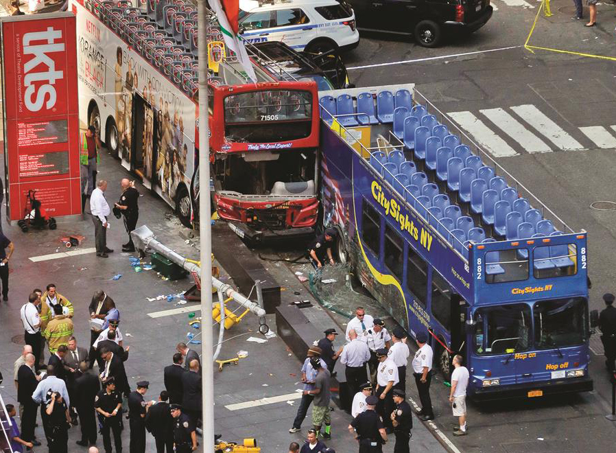 Two double-decker tour buses sit Tuesday in Times Square after colliding. (AP Photos)