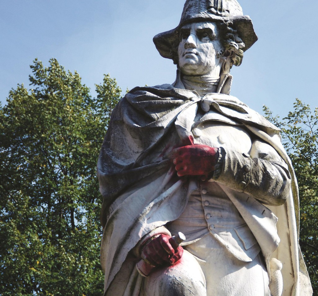 A statue of George Washington in Mill Hill Park in Trenton vandalized with red paint on its hands. (AP Photo/The Trentonian, Jackie Schear)