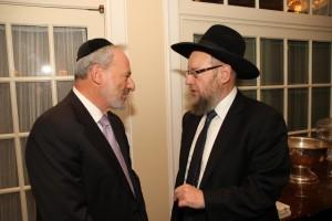 Mr. Ralph Rieder speaking to Rabbi Shmuel Bloom.