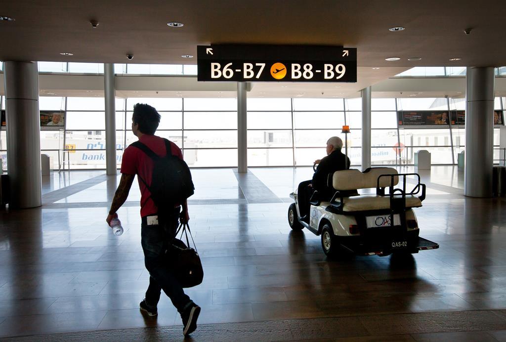 A passenger walking to his boarding gate at Ben Gurion Airport. (Moshe Shai/Flash90)