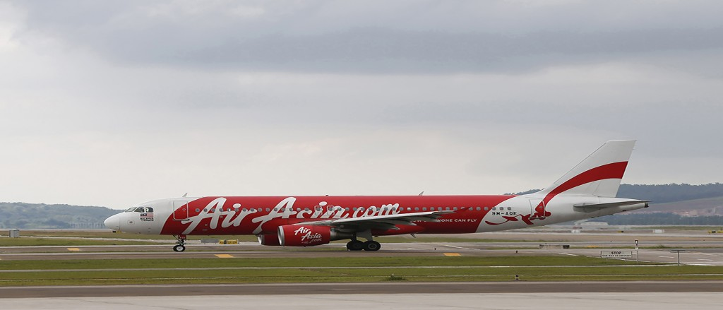 (AP Photo/Vincent Thian) In this Nov. 26, 2014 photo, an AirAsia Airbus A320-200 passenger jet is seen taxing on the tarmac in Sepang, Malaysia.