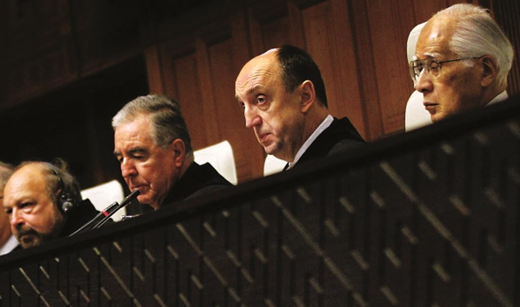 During a session of the International Court of Justice in The Hague, The Netherlands: President Peter Tomka of Slovakia (C), Judge Hisashi Owada (R) from Japan and Vice President Bernado Setulveda-Amor (2nd L) of Mexico during the judgment on a territorial dispute between Chile and Peru.  (BAS CZERWINSKI/AFP/Getty Images)