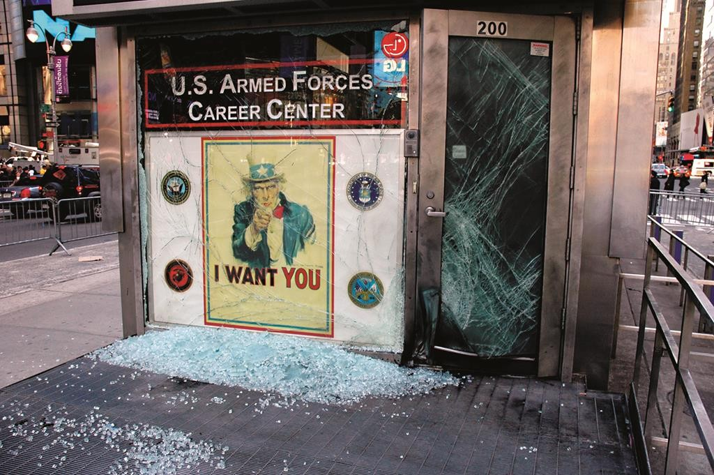 A bomb shattered the window and door of a military recruiting center in Times Square (top) on March 6, 2008. The bomber escaped on a blue bicycle (bottom), which was recovered several blocks away. (FBI)