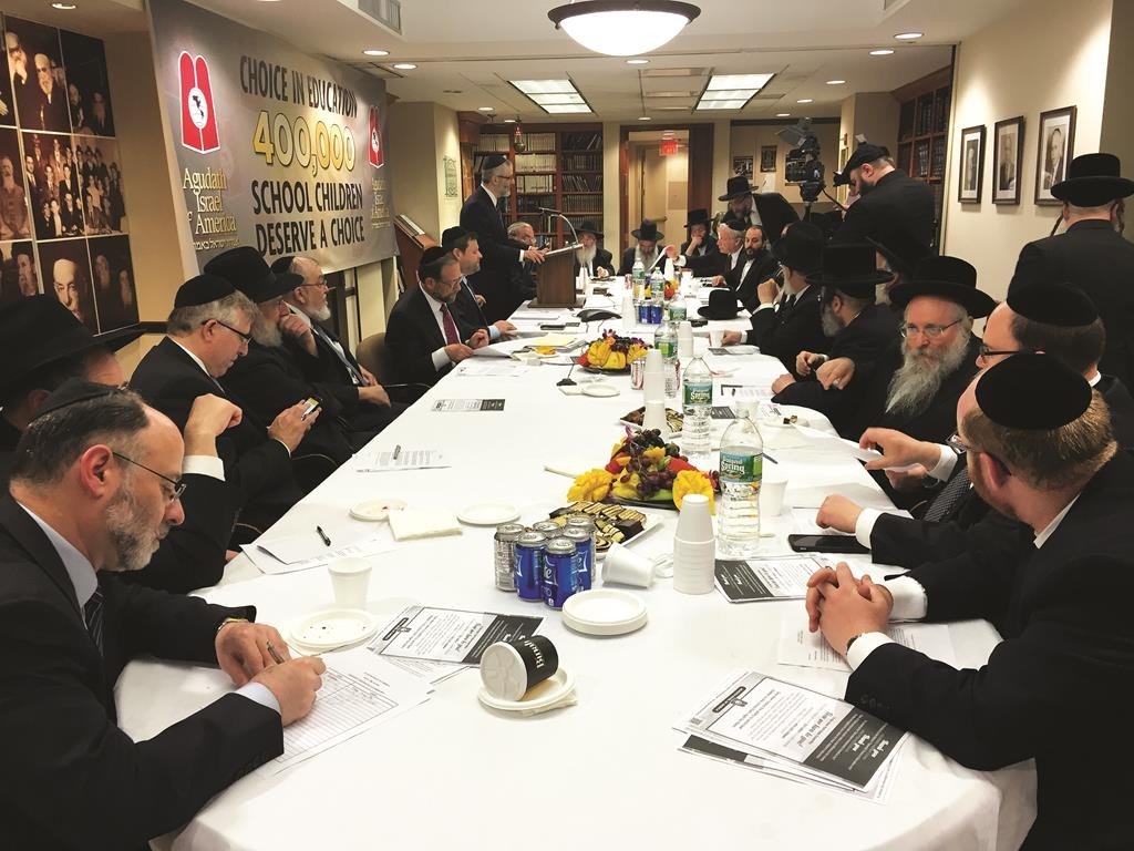 """Rabbi Chaim Dovid Zwiebel speaks Tuesday at an """"emergency meeting"""" at the Agudah office to announce the start of a lobbying effort for Gov. Andrew Cuomo's tuition aid bill. (Courtesy of Efraim Lebowitz)"""