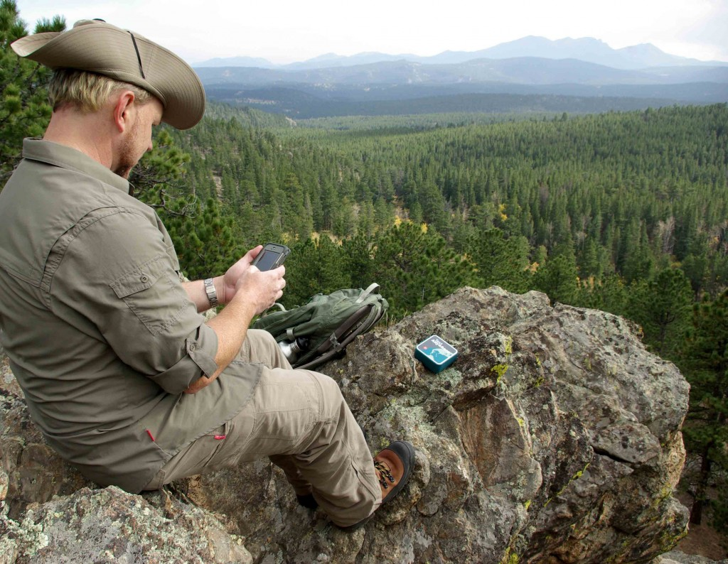 Jason Schwartz, a survival expert and senior editor of bushcraft blog Rocky Mountain Bushcraft, uses satellite-based two-way texting device Text Anywhere with an iPhone 5 to communicate from the backcountry, beyond cell service. (Photo by Monica Tymcio/Rocky Mountain Bushcraft)