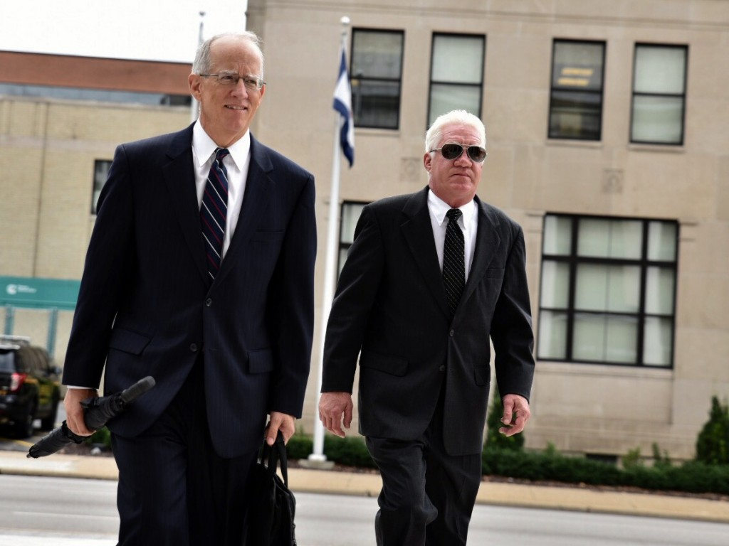 Former Freedom Industries executive Dennis Farrell, right, enters the federal courthouse with attorney Michael Carey for a plea hearing on federal charges stemming from the January 2014 chemical leak in Charleston, West Virginia, on Tuesday, Aug., 18. (AP Photo/Tyler Evert)