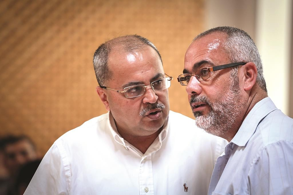 MKs Ahmad Tibi (L) and Saadia Osama at the High Court hearing on Palestinian prisoner Muhammed Allaan's petition to be released.  (Hadas Parush/Flash90)