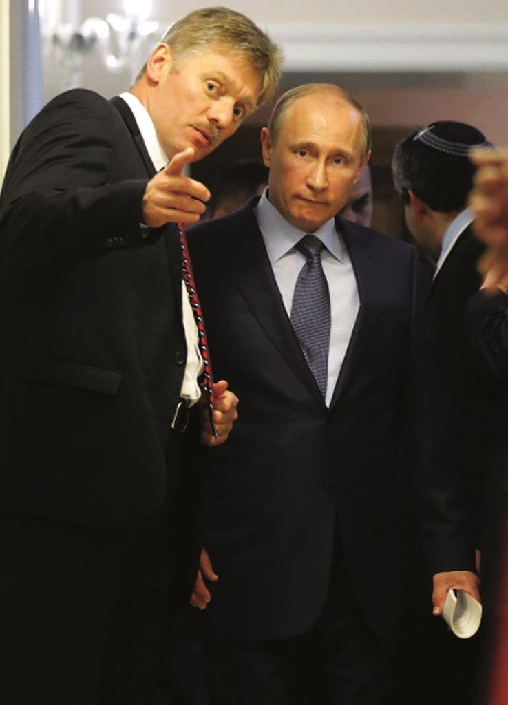 Russia's President Vladimir Putin (C) listens to his press secretary Dmitry Peskov (L) before a press conference following the talks with Israeli Prime Minister Benjamin Netanyahu at the Bocharov Ruchei state residence in the Black Sea resort of Sochi,on May 14, 2013. Putin warned today against any moves that would further destabilise the situation in Syria, speaking after talks with the visiting Israeli Prime Minister. AFP PHOTO/ POOL/ MAXIM SHIPENKOV (Photo credit should read MAXIM SHIPENKOV/AFP/Getty Images)