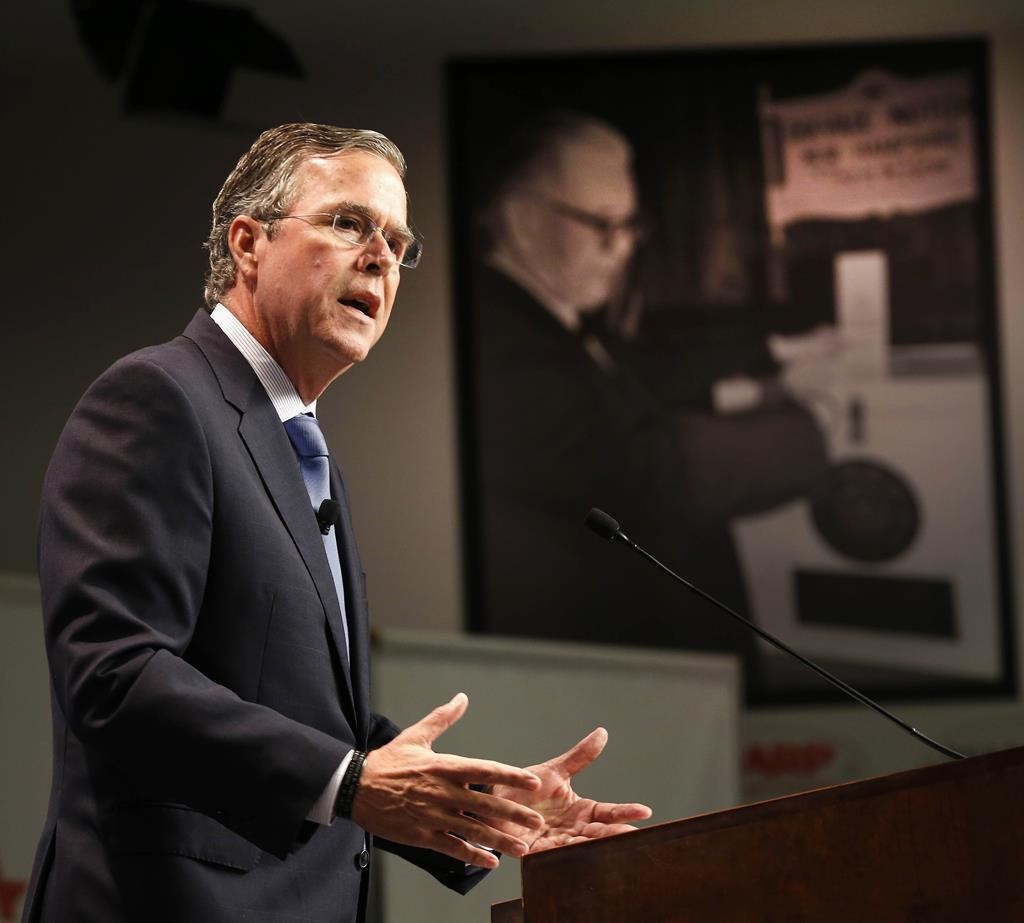 Republican presidential candidate, former Florida Gov. Jeb Bush announces his plan to end President Obama's health care law, Tuesday, in Manchester, N.H. (AP Photo/Jim Cole)