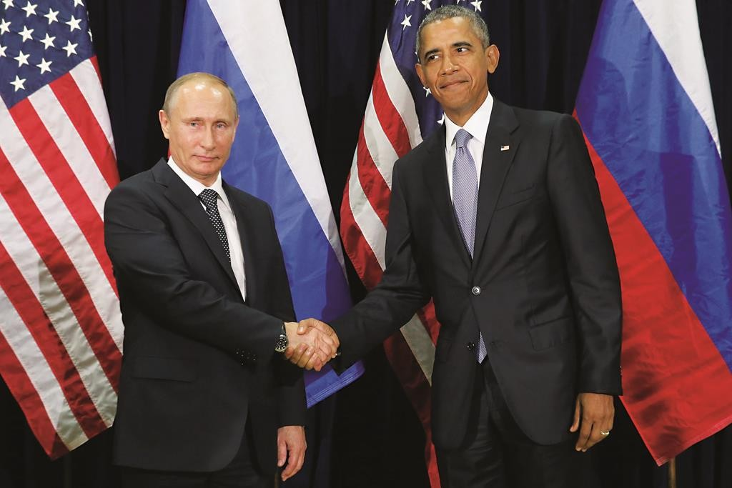 Russian President Vladimir Putin (L) and President Barack Obama shake hands for the cameras before the start of a bilateral meeting at United Nations headquarters, September 28, 2015, in New York City. (Chip Somodevilla/Getty Images)