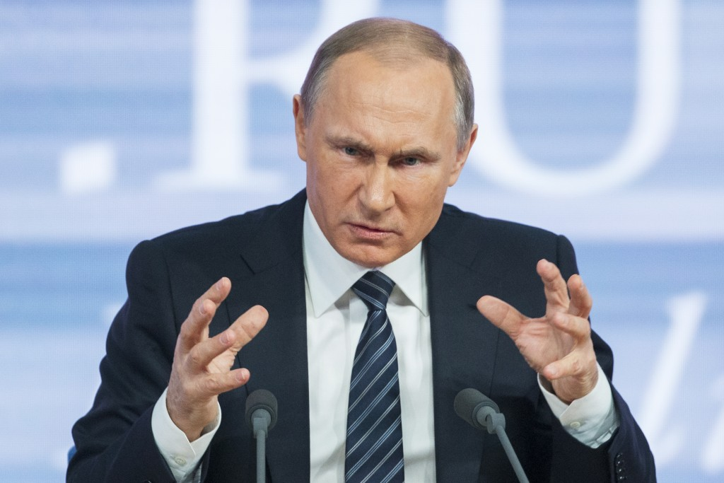 Russian President Vladimir Putin gestures during his annual news conference in Moscow, Russia, Thursday. (AP Photo/Alexander Zemlianichenko)