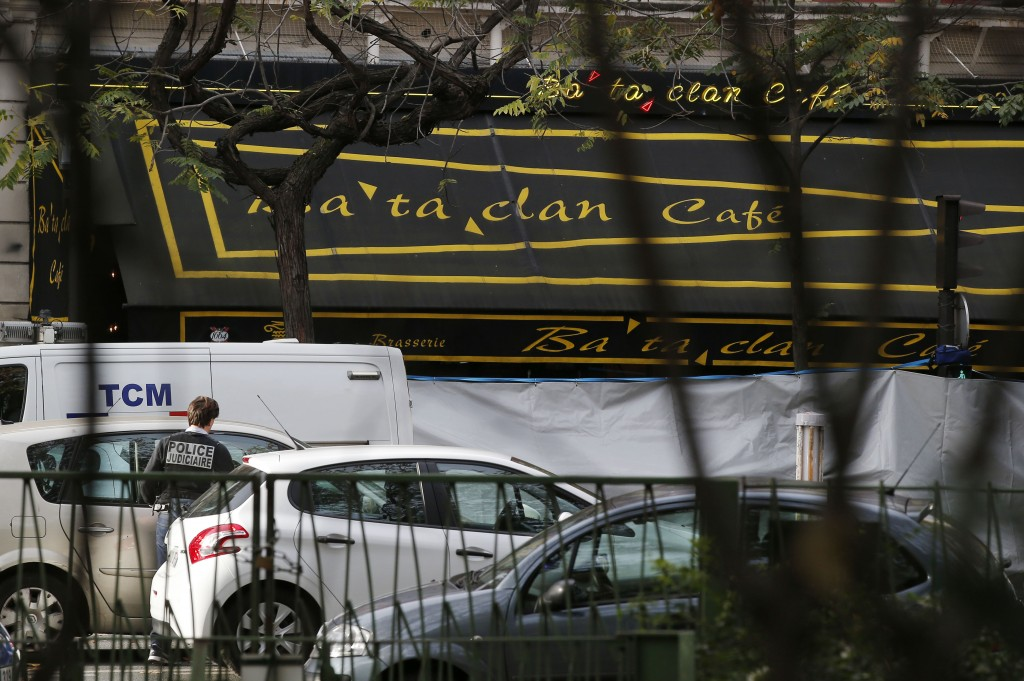 A judicial police officer works outside the Bataclan concert hall, Saturday, Nov. 14, 2015 in Paris. French President Francois Hollande said more than 120 people died Friday night in shootings at Paris cafes, suicide bombings near France's national stadium and a hostage-taking slaughter inside a concert hall. (AP Photo/Michel Euler)