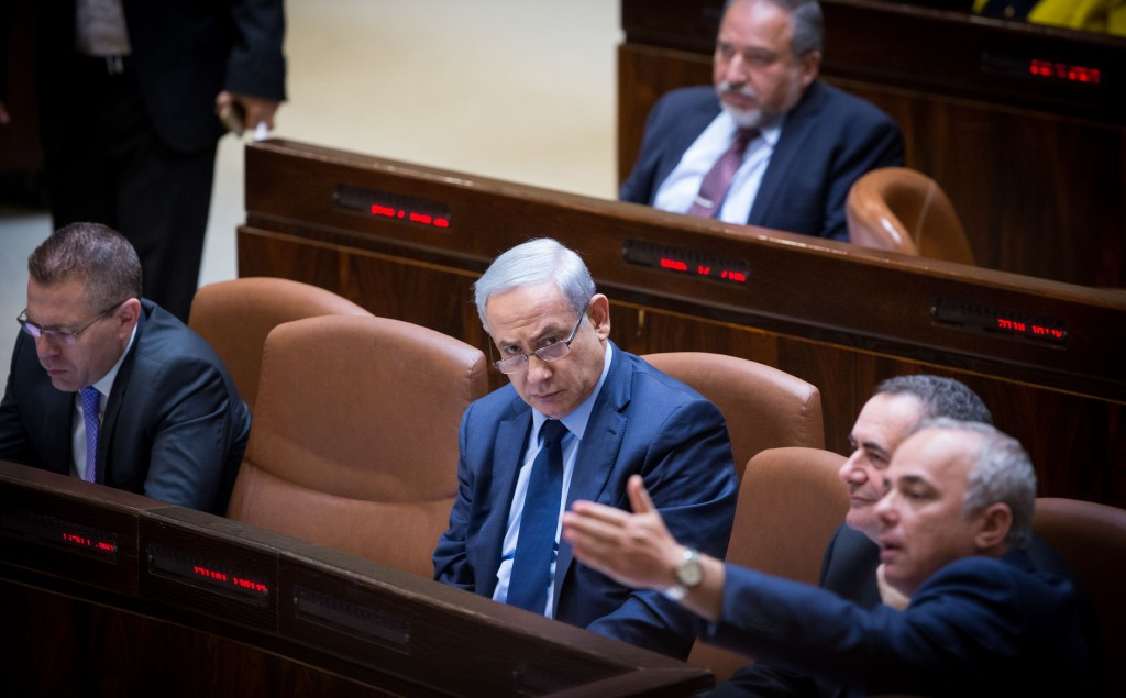 Israeli Prime Minister Binyamin Netanyahu, and Energy Minister Yuval Steinitz, Israel's energy minister (gesturing, lower right), seen in the Knesset on Wednesday. Seated between them is Minister of Intelligence and Transportation Yisrael Katz. (Miriam Alster/Flash90)