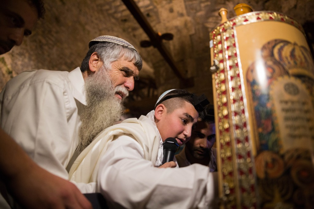 13-year-old Naor Ben-Ezra (Shalev) reads from the Torah during his Bar Mitzvah at the Kotel, December 17, 2015, Naor was critically injured in a stabbing attack in Pisgat Zeev in Jerusalem in October. Photo by Yonatan Sindel/Flash9
