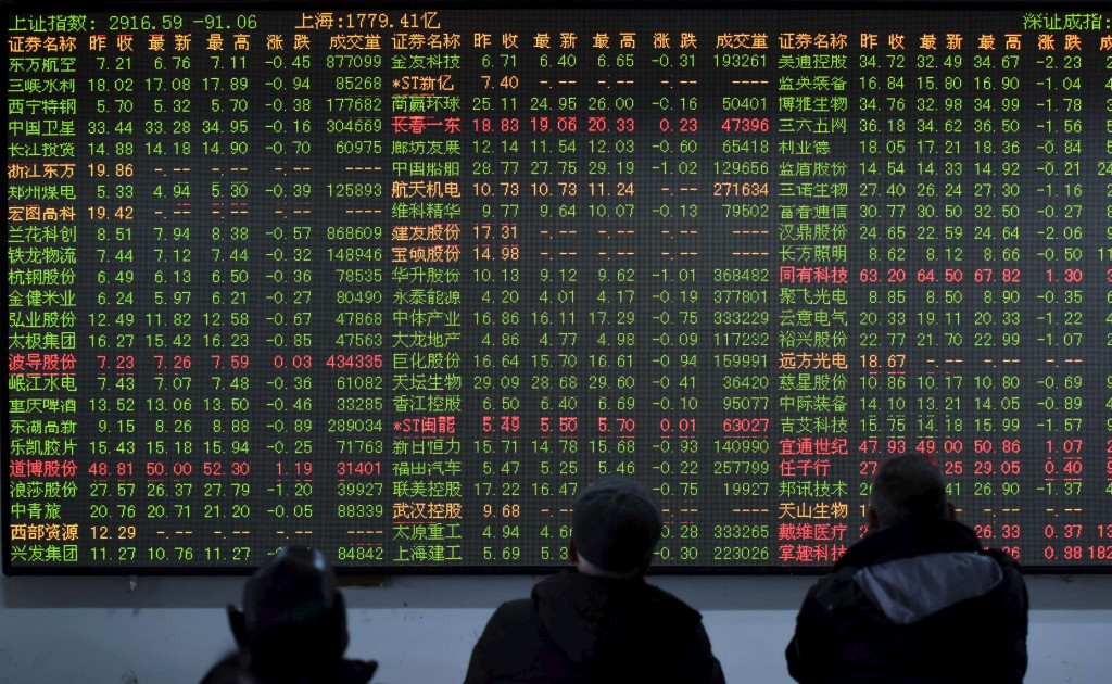 Investors look at an electronic screen showing the stock information at a brokerage house in Hangzhou, Zhejiang Province, China, January 15, 2016. China stocks dropped more than 3 percent on Friday, capping another tumultuous week in which the Shanghai Composite index tried and failed to stay above lows hit during last year's summer crisis. REUTERS/Stringer ATTENTION EDITORS - THIS PICTURE WAS PROVIDED BY A THIRD PARTY. THIS PICTURE IS DISTRIBUTED EXACTLY AS RECEIVED BY REUTERS, AS A SERVICE TO CLIENTS. CHINA OUT. NO COMMERCIAL OR EDITORIAL SALES IN CHINA.