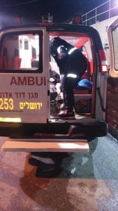 A victim of the Kever Rochel attack is taken into an ambulance. (Mosdos Kever Rochel)