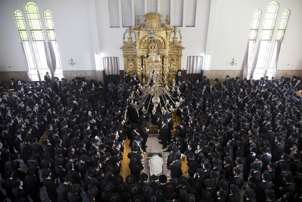 Ultra-Orthodox Jews mourn over the body of Rabbi Chaim Shlomo Leibowitz, Lithuanian-Orthodox leader, head of the Ponevezh Yeshiva, during his funeral, in Bnei Brak, Israel, Sunday, Feb. 28, 2016. Leibowitz was 83. (AP Photo/Oded Balilty)
