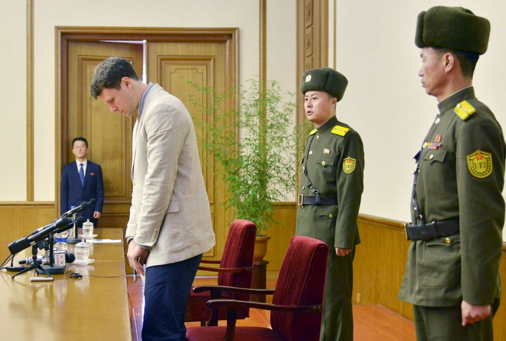 """Otto Frederick Warmbier (3rd R), a University of Virginia student who has been detained in North Korea since early January, attends a new conference in Pyongyang, North Korea, in this photo released by Kyodo February 29, 2016. Warmbier was detained for trying to steal a propaganda slogan from his Pyongyang hotel and has confessed to """"severe crimes"""" against the state, the North's official media said on Monday. Warmbier, 21, was detained before boarding his flight to China over an unspecified incident at his hotel, his tour agency told Reuters in January. Mandatory credit REUTERS/Kyodo ATTENTION EDITORS - FOR EDITORIAL USE ONLY. NOT FOR SALE FOR MARKETING OR ADVERTISING CAMPAIGNS. THIS IMAGE HAS BEEN SUPPLIED BY A THIRD PARTY. IT IS DISTRIBUTED, EXACTLY AS RECEIVED BY REUTERS, AS A SERVICE TO CLIENTS. MANDATORY CREDIT. JAPAN OUT. NO COMMERCIAL OR EDITORIAL SALES IN JAPAN."""