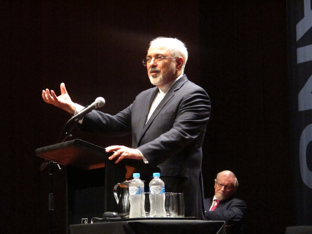 Iran's Foreign Minister Mohammad Javad Zarif gives a speech Tuesday, March 15, 2016, in Canberra, Australia. Zarif said Tuesday that he had deliberately negotiated the wording of the latest United Nations resolution restraining his country's nuclear program to ensure that the test-firing of nuclear-capable Iranian missiles would be legal. (AP Photo/Rod McGuirk)