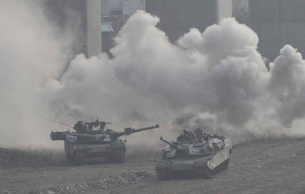 South Korean army K-1 tanks move during an annual exercise in Yeoncheon, near the border with North Korea, Thursday, March 3, 2016. North Korea fired six short-range projectiles into the sea off its east coast Thursday, Seoul officials said, just hours after the U.N. Security Council approved the toughest sanctions on Pyongyang in two decades for its recent nuclear test and long-range rocket launch. (AP Photo/Ahn Young-joon)