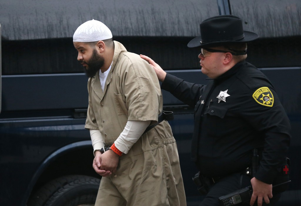 In this Dec. 17, 2015 photo, Mufid Elfgeeh is escorted under heavy guard into the Federal Building for a hearing in Rochester, N.Y. (Jamie Germano/Democrat & Chronicle via AP, File)