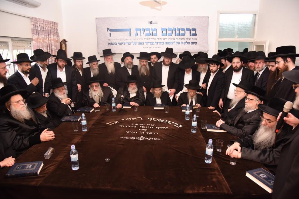 The Nesius of the Dirshu orgenization at the Siyum of Daf HaYomi BeHalacha at the home of Hagaon Harav Shteinman shlita. From left to right, shlita, Modzhitzer rebbe, Hagaon Harav Shimon Badani, Hagaon Harav Dov Povarsky, Sanzer rebbe, Vizhnitzer rebbe, Harav Yisrael Hager, Hagaon harav Aharon Leib Shteinman, Hagaon Harav Gershon Edelstein, Hagaon Harav Yitzchak Sheiner, Seret-Vizhnitzer rebbe, Alexsander rebbe, Rabbi Dovid Hofstater (partially obstructed) founder of the Dirshu organization, speaking. (JDN)