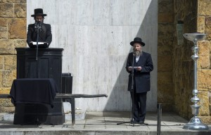 Rabbi Meir Chaim Gestetner (left) speaks, as Rabbi Tamas Paskesz interprets, at the levayah. (Tibor Illyes/MTI via AP)