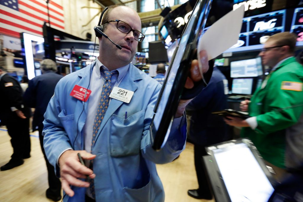 Trader Peter Mancuso on the floor of the New York Stock Exchange on Wednesday. (AP Photo/Richard Drew)