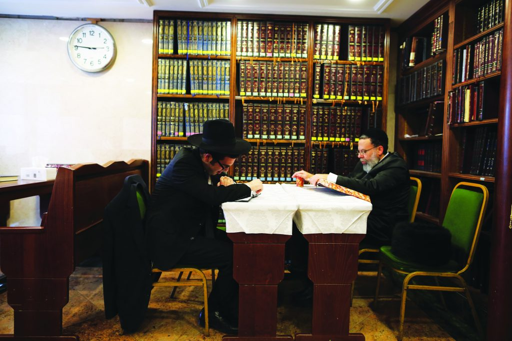 Men study in a shul in London, England. (Dan Kitwood/Getty Images)