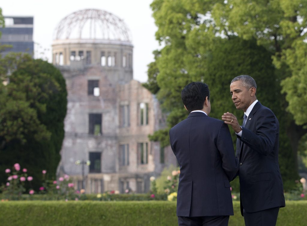 U.S. President Barack Obama and Japanese Prime Minister Shinzo Abe speak with the Atomic Bomb Dome seen at rear at the Hiroshima Peace Memorial Park in Hiroshima, western Japan, Friday, May 27, 2016. Obama on Friday became the first sitting U.S. president to visit the site of the world's first atomic bomb attack, bringing global attention both to survivors and to his unfulfilled vision of a world without nuclear weapons. (AP Photo/Carolyn Kaster)